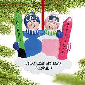 Personalized Ski Couple in Blue and Pink Christmas Ornament